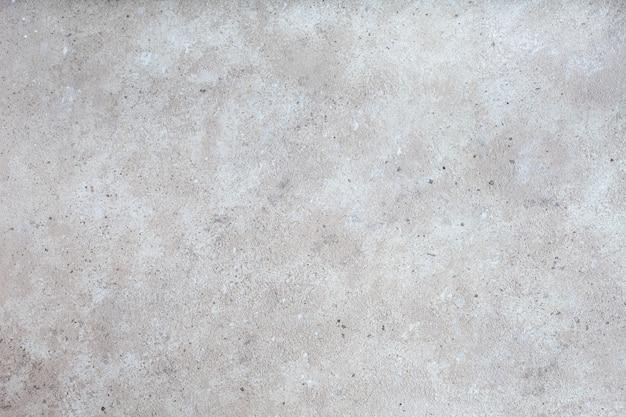 Серая предпосылка текстуры бетонной стены.