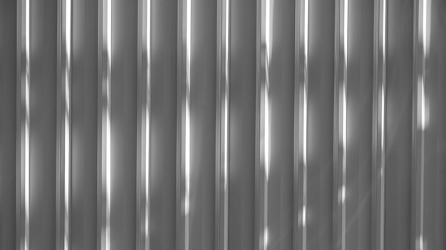Grey corrugated metal wall with shadow
