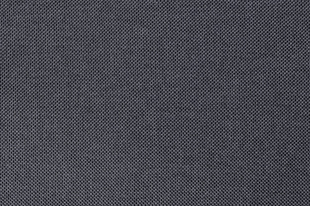 Grey cotton fabric texture background, seamless surface of natural textile.