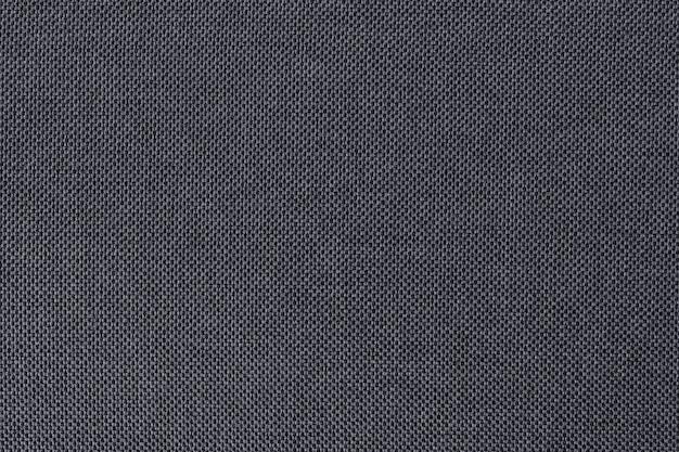 Серая предпосылка текстуры хлопко-бумажной ткани, безшовная поверхность естественной ткани.