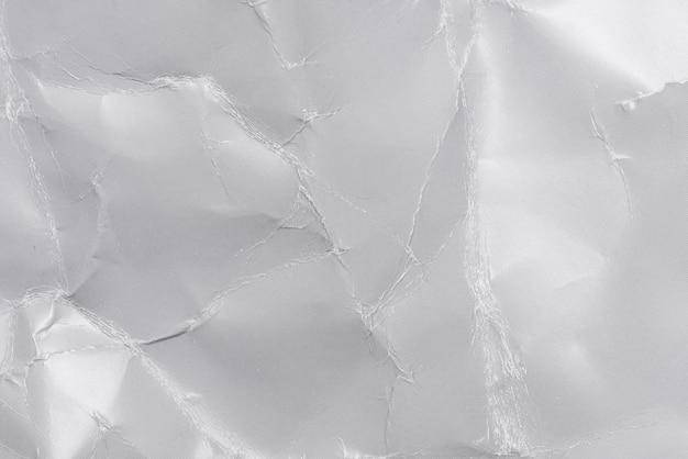 灰色のしわくちゃ紙テクスチャ背景