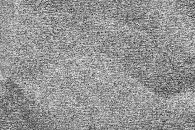 灰色のしわくちゃの紙のテクスチャ背景