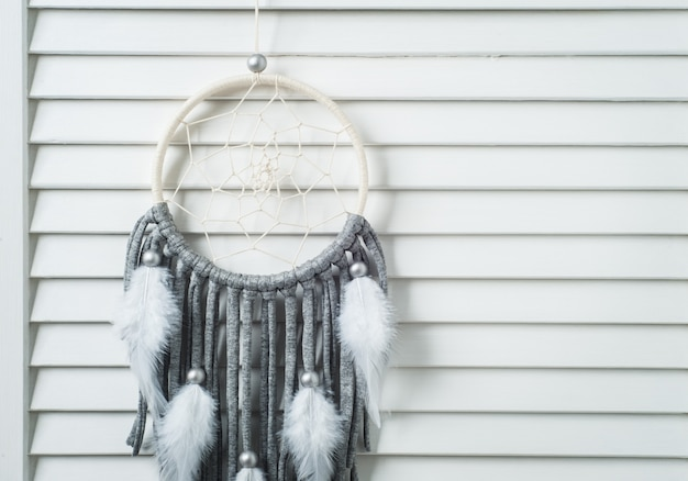 Grey dream catcher with cotton threads