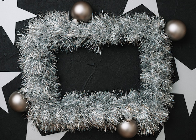 Grey frame from tinsel on table
