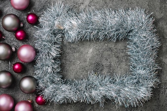 Grey frame from tinsel with baubles
