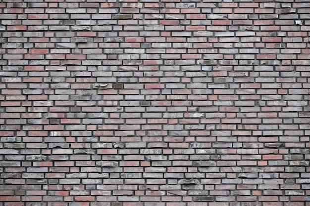 灰色のグランジレンガの壁の背景タイル張り