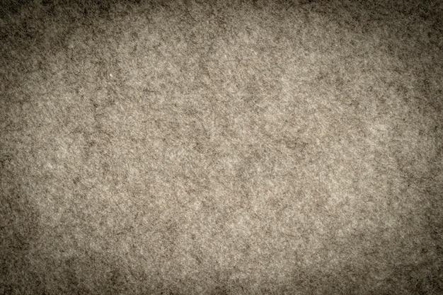 合成繊維の織り目加工の背景で作られた灰色の杢ニット生地。グレーのニット生地の質感。繊細な縞模様の背景、クローズアップ