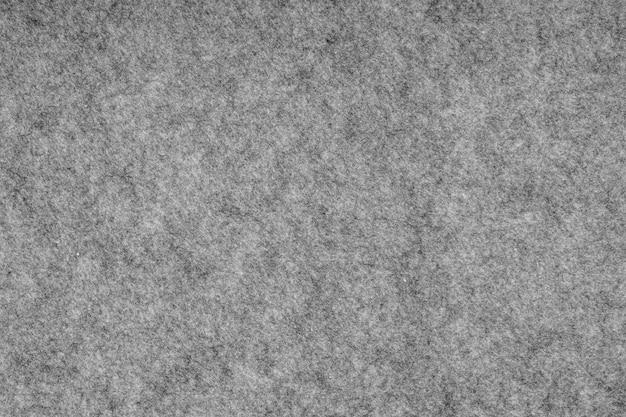 합성 섬유 질감 배경으로 만든 회색 헤더 니트 직물. 회색 니트 패브릭 질감입니다. 섬세한 줄무늬 패턴이 있는 배경, 클로즈업