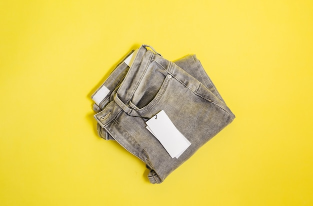 Grey jeans with an empty tag