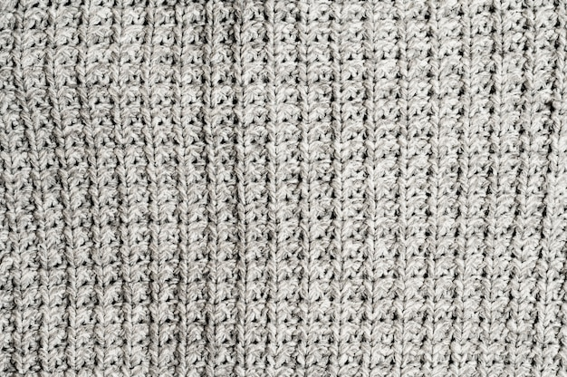 Grey knitted fabric background