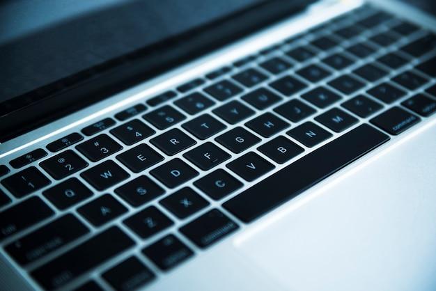 Grey laptop keyboard close up
