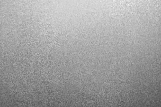 グレーの革人工皮革のテクスチャの背景
