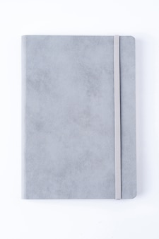 Grey leather notebook isolated on white background