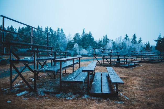 Grey metal bench during daytime