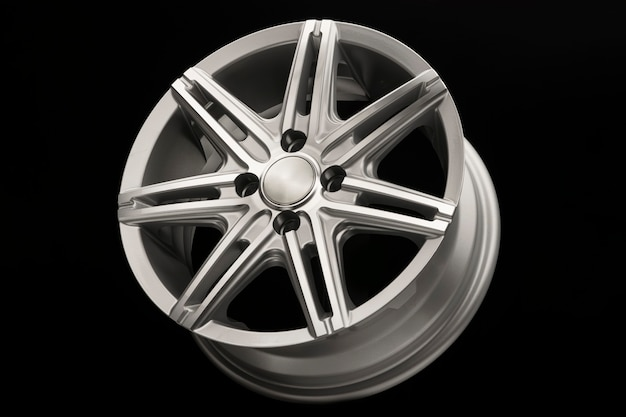 Grey new alloy wheel for car, side view close-up, polished.