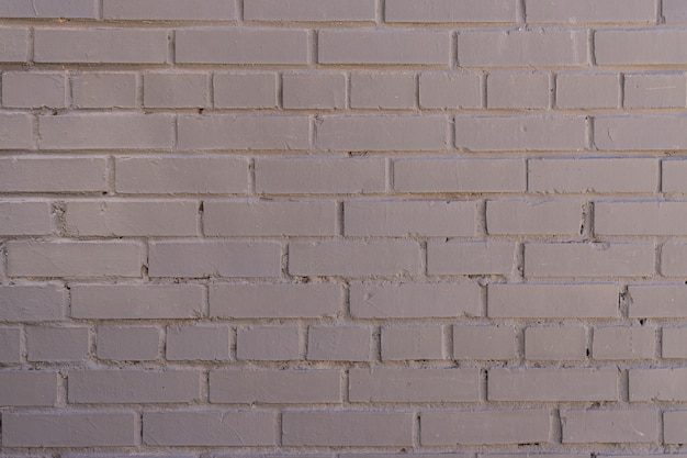 Grey painted brick wall background, textured backdrop. copy space for designers.