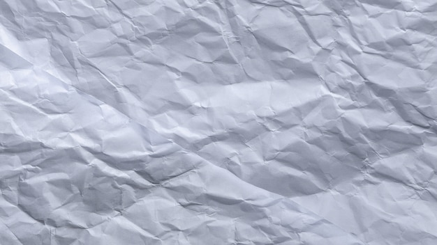 Grey paper crumple texture background.