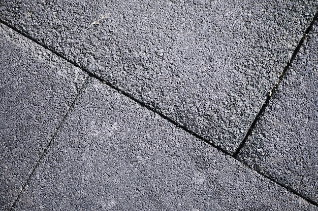 Grey paving stone, pedestrian walkway, pavement close up, the texture, top view.cement brick squared stone floor background. concrete paving slabs. paving slabs