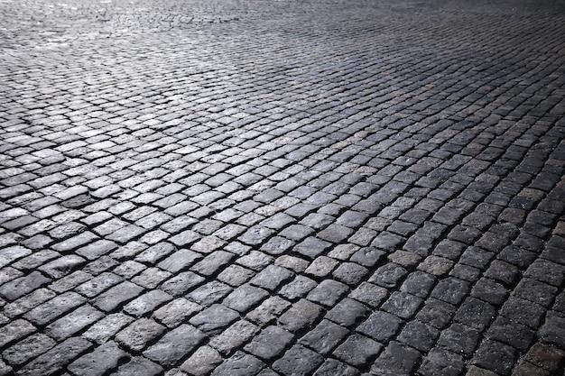 Серый брусчатка, пешеходная дорожка, тротуар заделывают, текстура, вид сверху. цементный кирпич в квадрате каменный пол фон. бетонная тротуарная плитка. тротуарная плитка