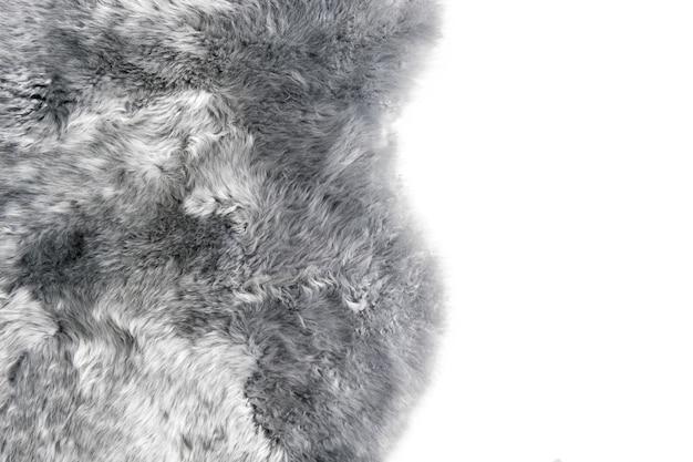 Grey sheepskin rug background. sheep fur texture