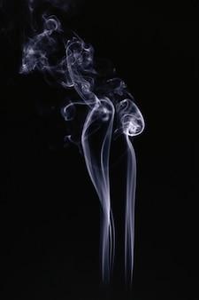 Grey smoke waves on black background