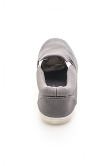 Grey sneakers on white background