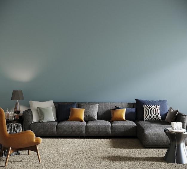 青い壁の前に灰色のソファとオレンジ色のアームチェア