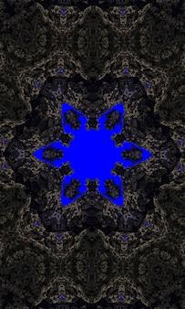 Grey stone flower kaleidoscope on very dark blue background shiny frame background. granite mineral texture vertical image.