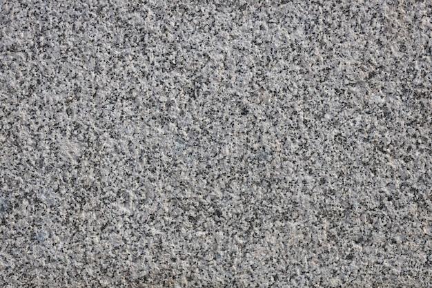 デザインの灰色の石の壁の花崗岩のテクスチャ背景