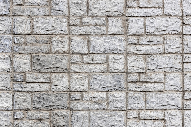 Grey stone wall of texture tiles. high quality photo