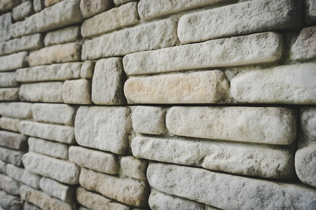 Grey stone wall textured background.