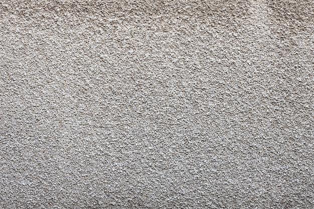 거친 질감의 회색 돌 벽입니다. 고품질 사진