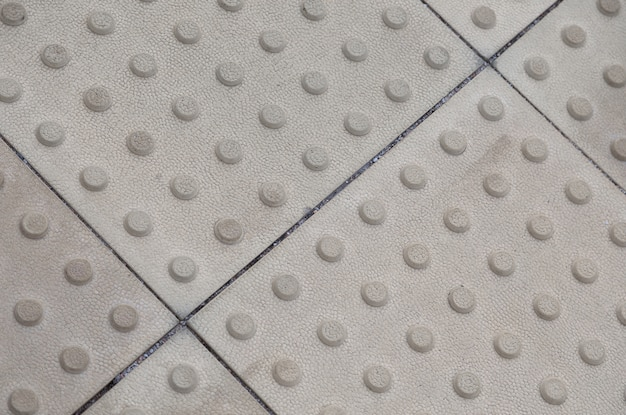 Grey tactile paving,  with texture
