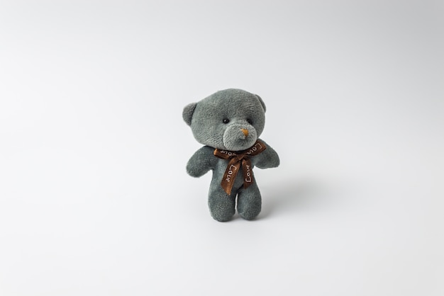 Grey teddy bear on white isolated background