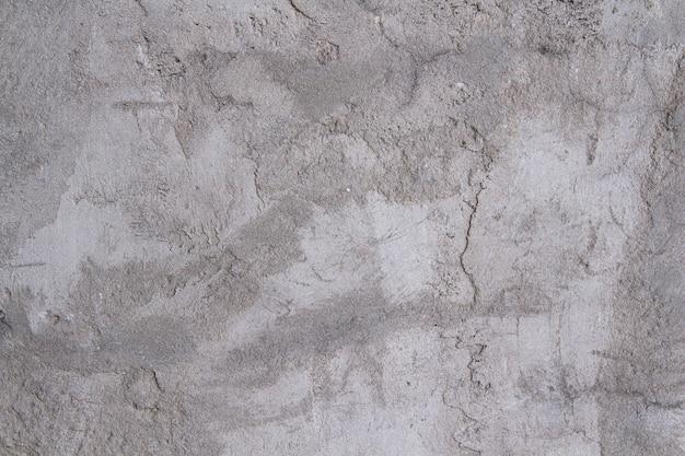 コンクリート石膏の灰色の質感。粗い白灰色の壁。
