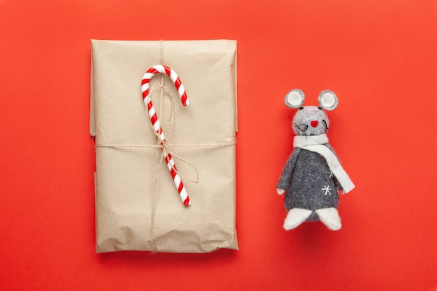 Grey toy rat, symbol of 2020 on chinese calendar and christmas gift wrapped in craft paper