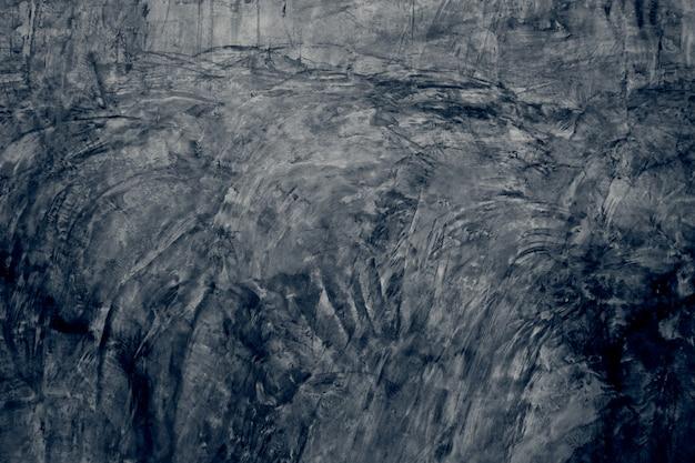 灰色のビンテージグランジ背景や暗いテクスチャ壁、レトロなパターンレイアウトとしてセメントまたは石の古い壁の空スペースのテクスチャ