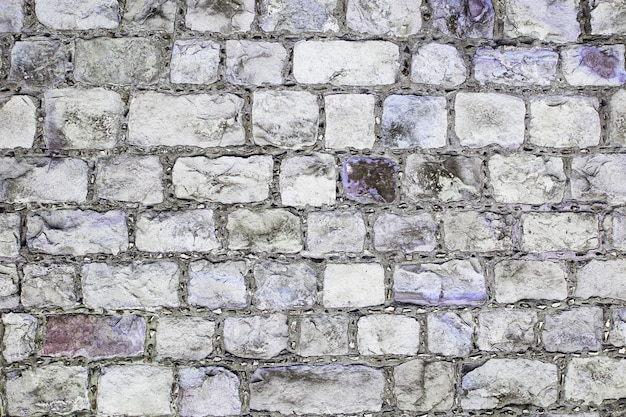 Grey and violet grunge brick wall background texture