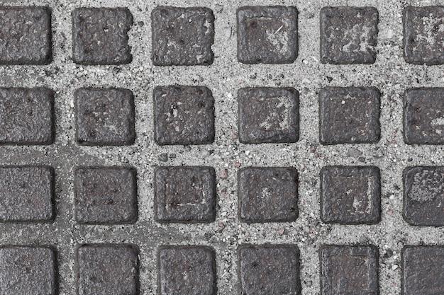 어두운 회색 사각형이있는 회색 벽