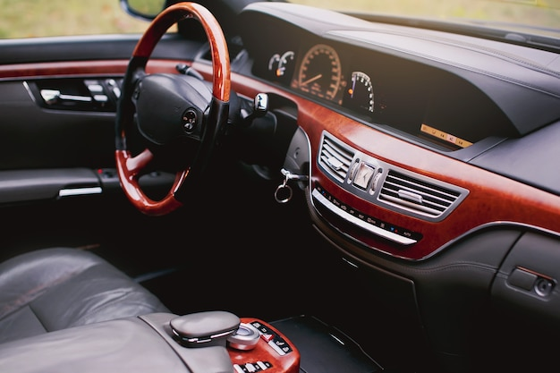 Grey and wood luxurious car interior