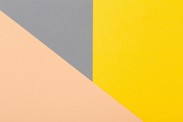 Grey, yellow and light beige cardboard sheets geometrical background