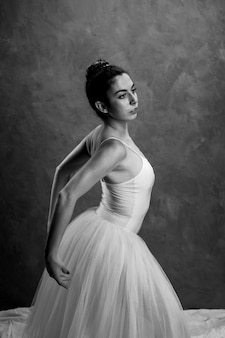Greyscale ballerina stretching her back