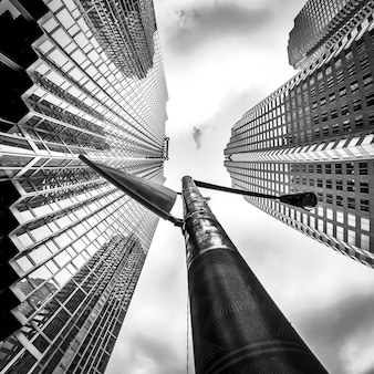 Greyscale low angle shot of high-rise buildings in the financial district of toronto canada