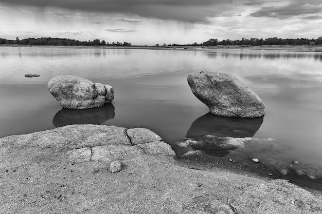 Greyscale view of the salor reservoir, caceres, extremadura, spain