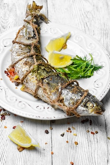 Grill fish on light plate