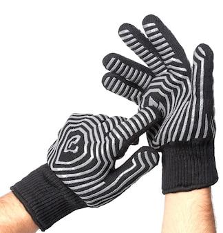 白い背景で隔離のグリル手袋