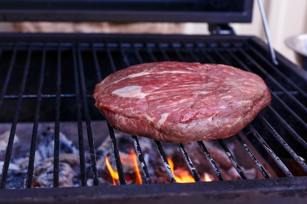 Grill meat. flame