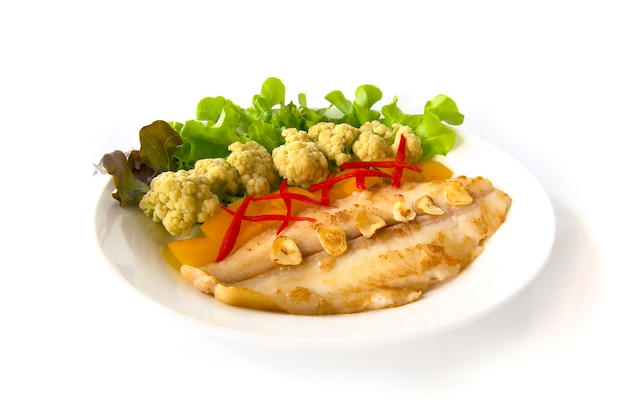 Grill  pangasius dory with cabbage flower and vegetables.