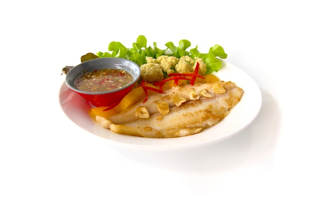 Grill  pangasius dory with dressing spicy sauce or seafood sauce