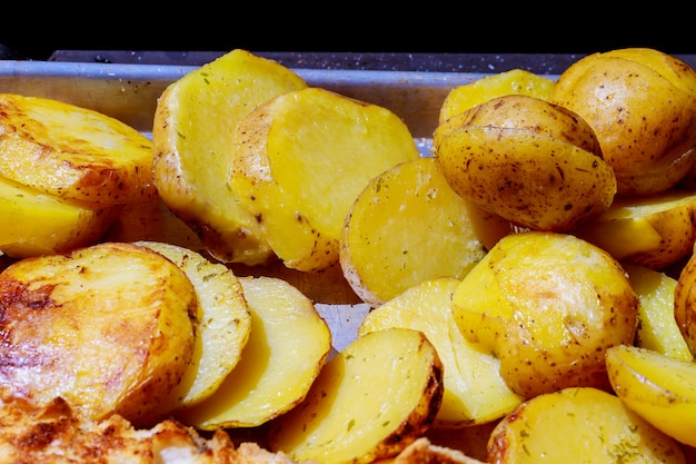Grill potatoes roasted on home fried potatoes on the grill background